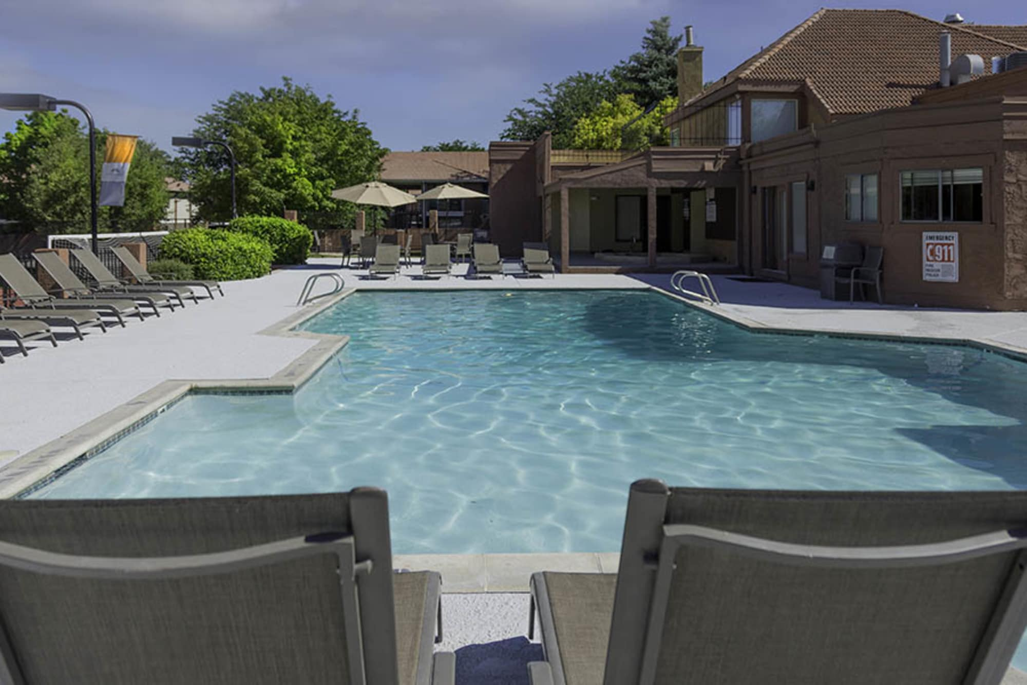Sparkling Community pool with Lounge Chairs at Shadowbrook Apartments