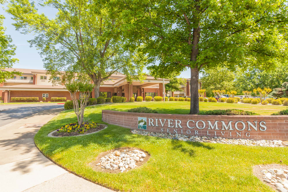 Exterior welcome sign at River Commons Senior Living in Redding, California