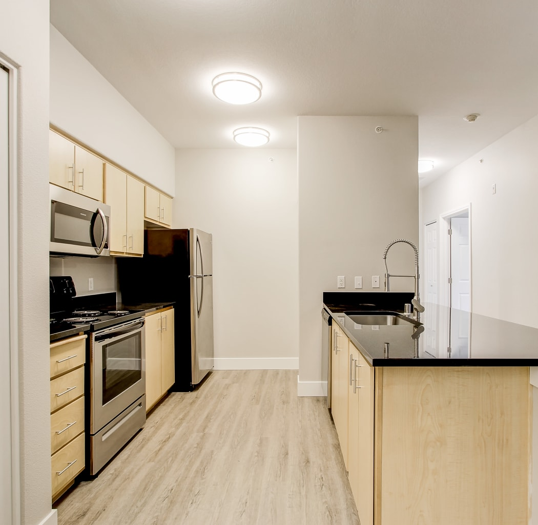 View of the kitchen and hallway at River Trail Apartments in Puyallup, Washington