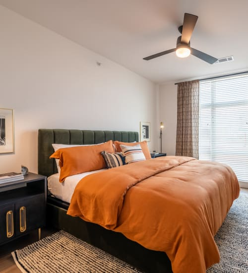 Bedroom with ceiling fan and huge windows for tons of light at The Langford in Dallas, Texas