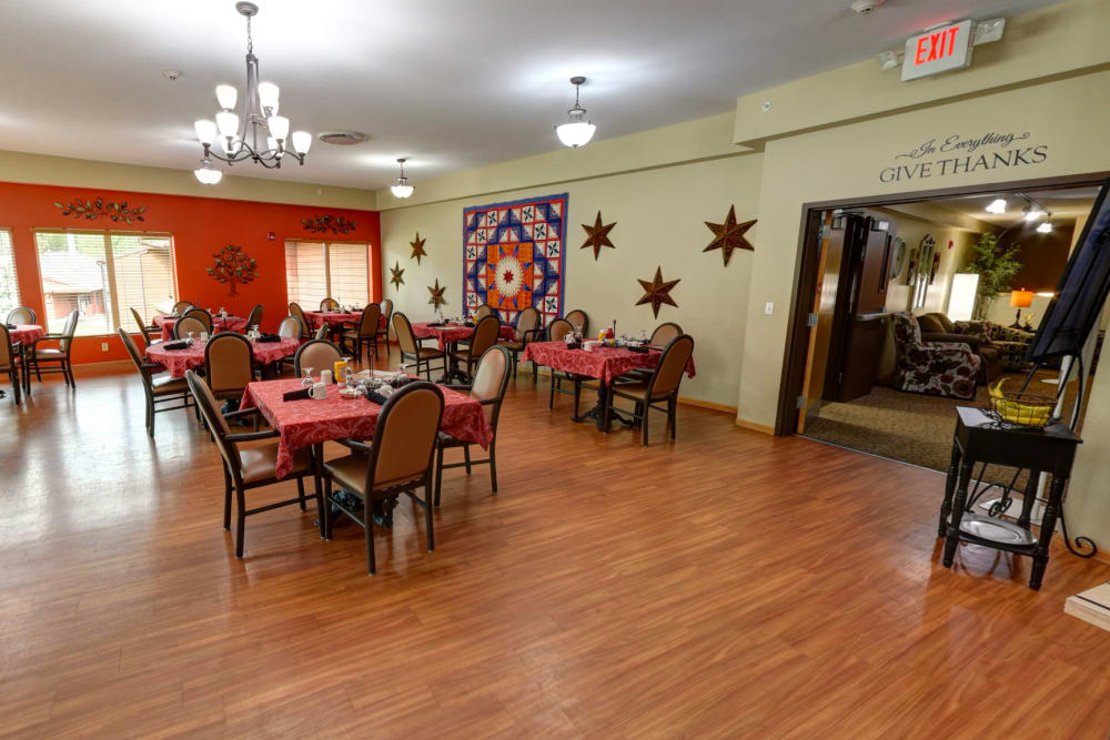 Spacious and brightly lit dining room at Garnett Place in Cedar Rapids, Iowa.