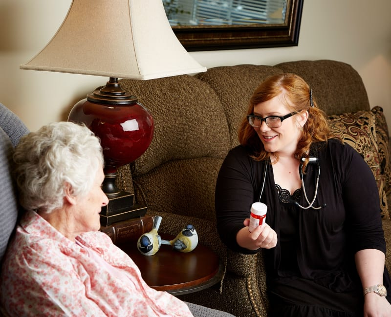 Residents and staff talking about medication at Deer Crest Senior Living in Red Wing, Minnesota