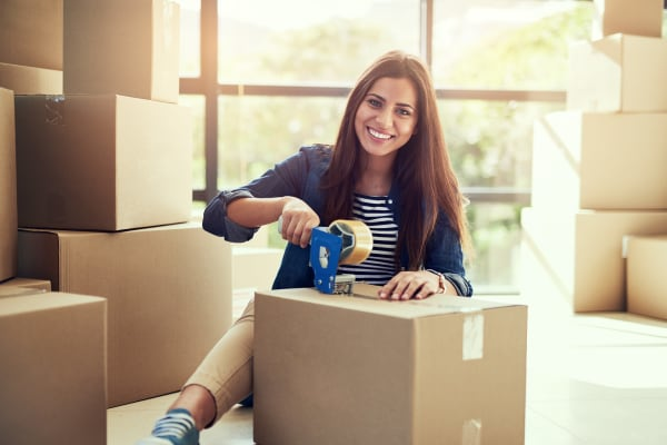 A woman packing boxes at Store It All Self Storage - Affordable in Laredo, Texas