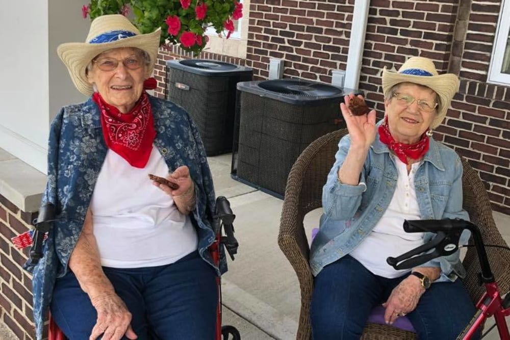 Residents in western attire at Villas of Holly Brook Chatham in Chatham, Illinois