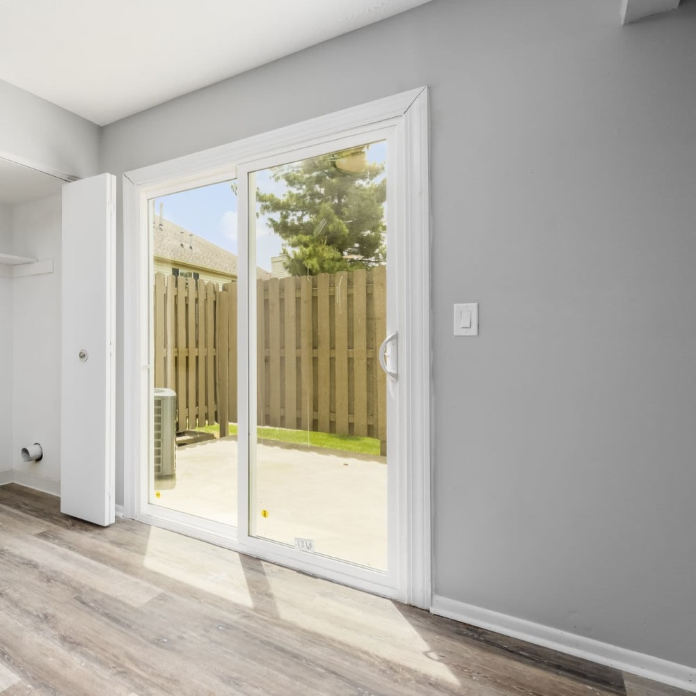 Large sliding glass doors out to patio at Hidden Acres East in Columbus, Ohio