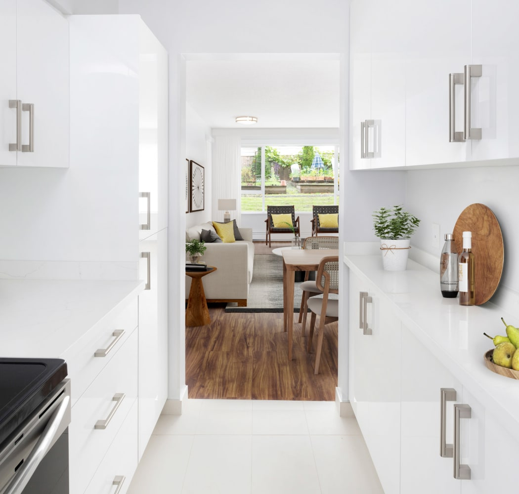 State-of-the-art kitchen with white cabinetry at Larchway Gardens in Vancouver, British Columbia