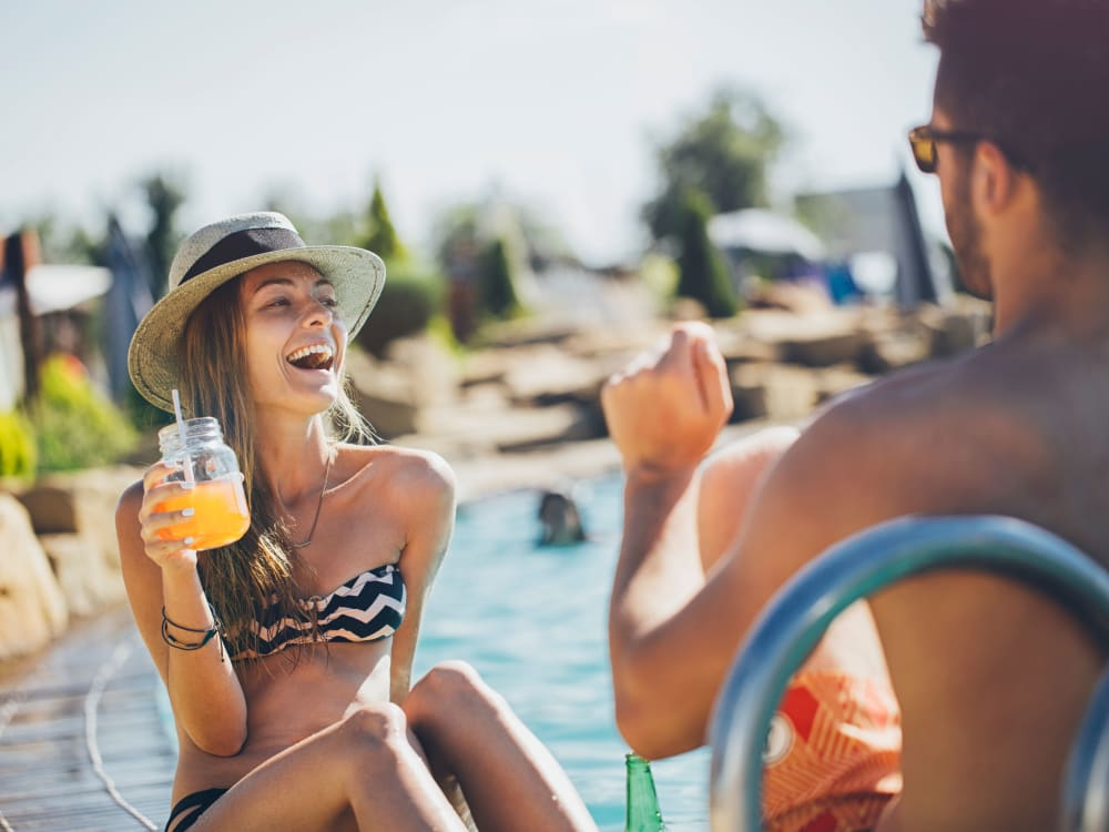 Resident  enjoying a sunny day by the pool at Haven Martinez in Martinez, California
