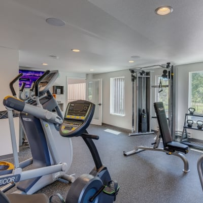 Onsite fitness center with cardio machines and free weights at Sofi Lakeside in Everett, Washington