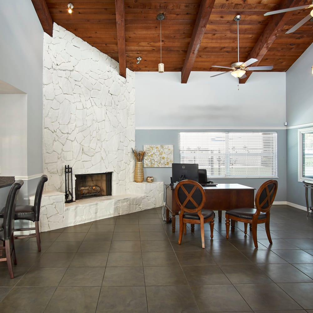 A clubhouse with a fireplace at Westwood @60 in Brandon, Florida
