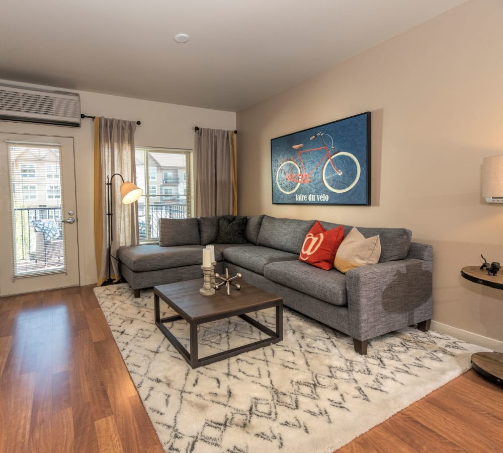 Spacious living room with a patio access at Eddyline at Bridgeport in Portland, Oregon