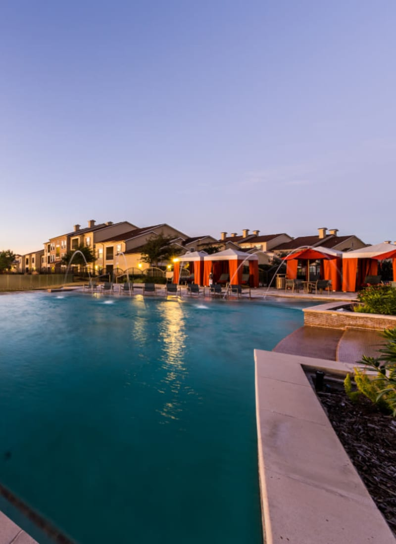 Sparkling pool with water features and gazebos at Marquis at the Reserve in Katy, Texas