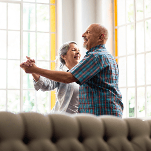 Two residents dancing in a lounge at Hanover Place in Tinley Park, Illinois