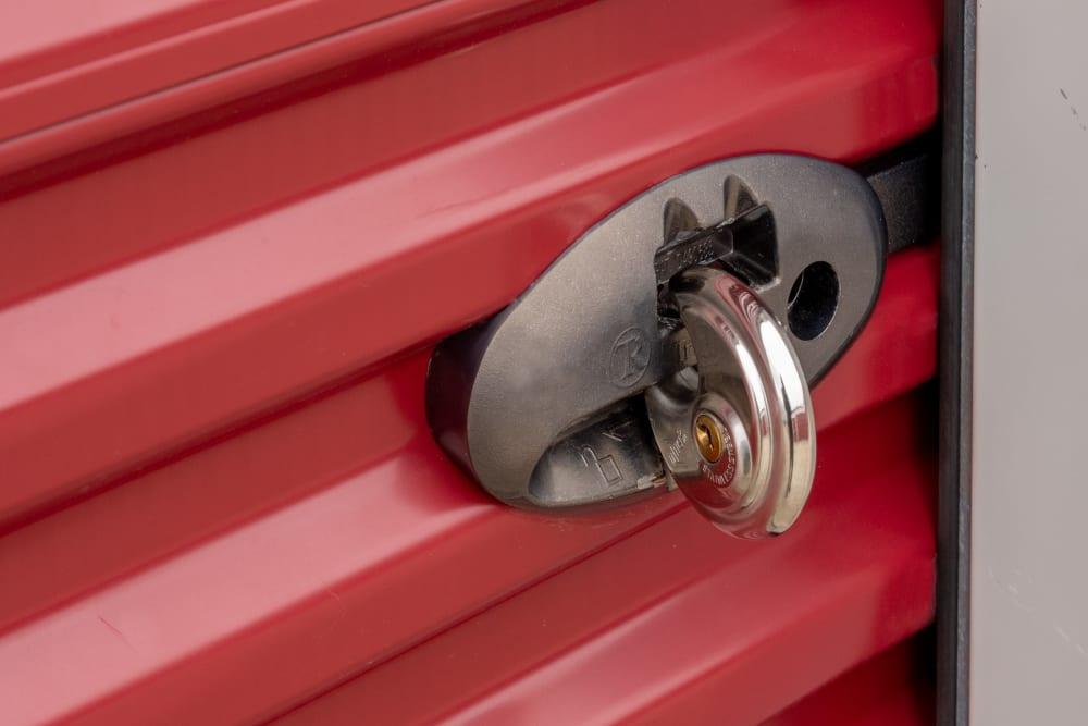 A lock on a red storage unit door at StayLock Storage in Hurricane, West Virginia