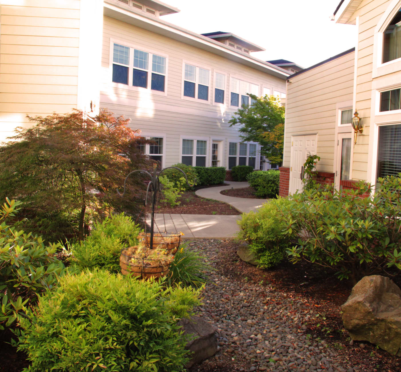 An outdoor walkway between apartments at Touchmark at Fairway Village in Vancouver, Washington