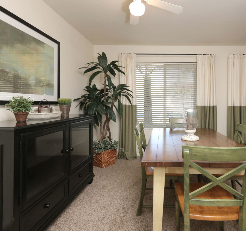 Well-decorated dining area in a model home at Overlook Point Apartments in Salt Lake City, Utah