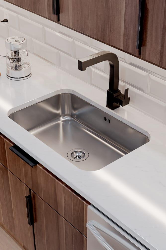 Stainless steel kitchen sink at Solana Stapleton Apartments in Denver, Colorado