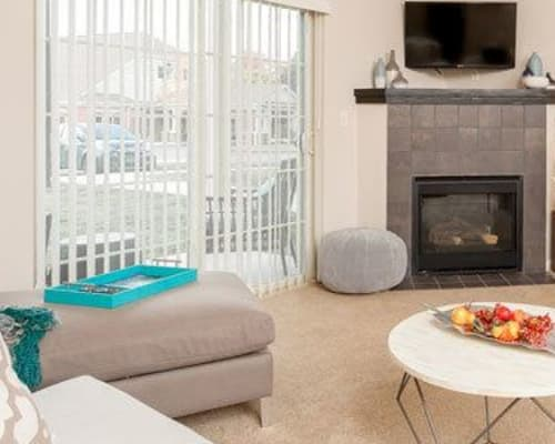 Living room with patio access at Reserve at Southpointe in Canonsburg, Pennsylvania