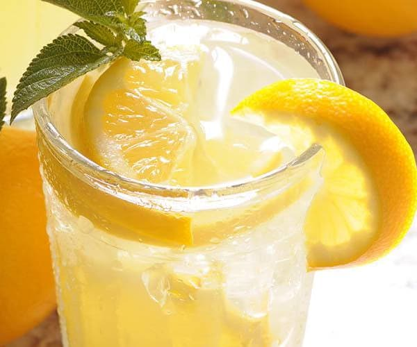 Refreshing glass of lemonade with mint