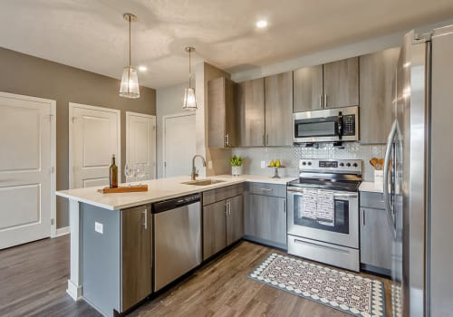 Bright, clean kitchen at Ellison Heights Apartments in Rochester, New York