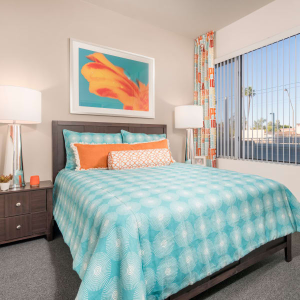 Well-decorated master bedroom with a ceiling fan in a model home at Tempe Metro in Tempe, Arizona