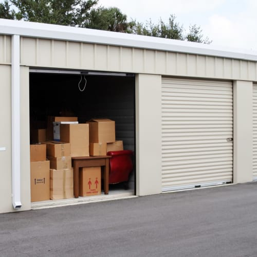 A wide, paved driveway to access an open unit at Red Dot Storage in Lee's Summit, Missouri