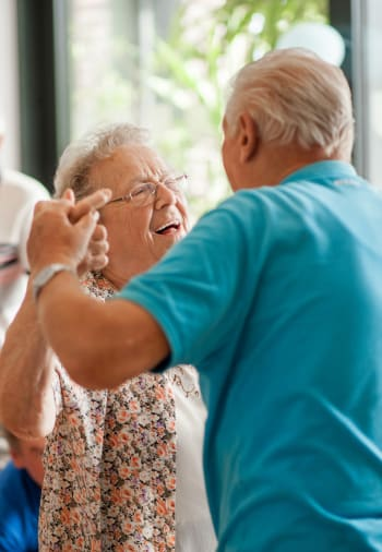 Two residents dancing at The Claiborne at Hattiesburg Assisted Living in Hattiesburg, Mississippi.