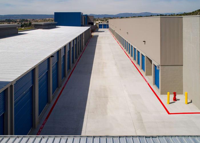 A driveway between storage units at Silverhawk Self Storage in Murrieta, California