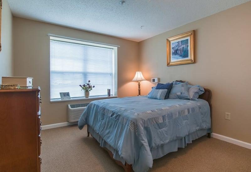 Senior living bedroom at Randall Residence of Newark in Newark, Ohio