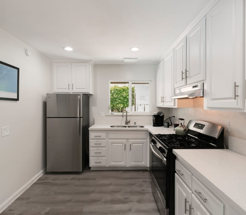 Bright kitchen with stainless steel appliances at The Heights at Grand Terrace in Grand Terrace, California