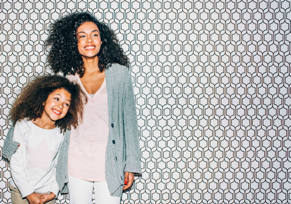 Resident mother and daughter posing for a photo at Sofi at Los Gatos Creek in San Jose, California