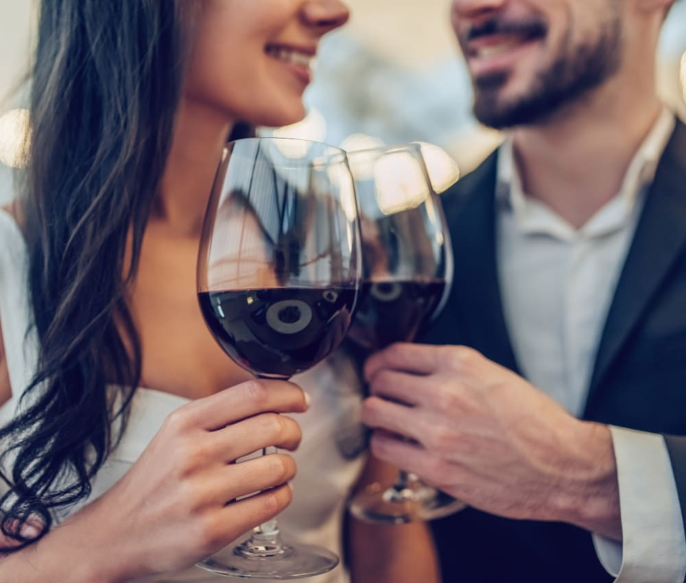Resident couple out for a meal and some fine wine on date night near Harbor Point Apartments in Mill Valley, California