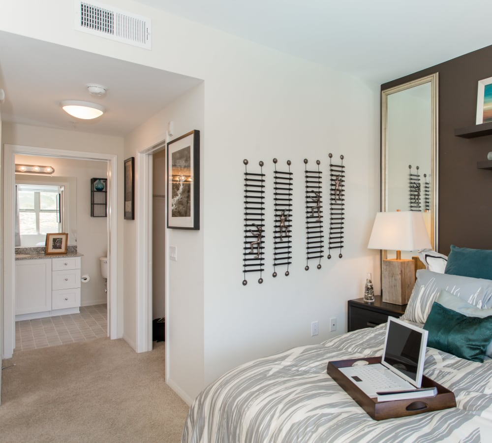 Main bedroom with a walk-in closet at Paragon at Old Town in Monrovia, California