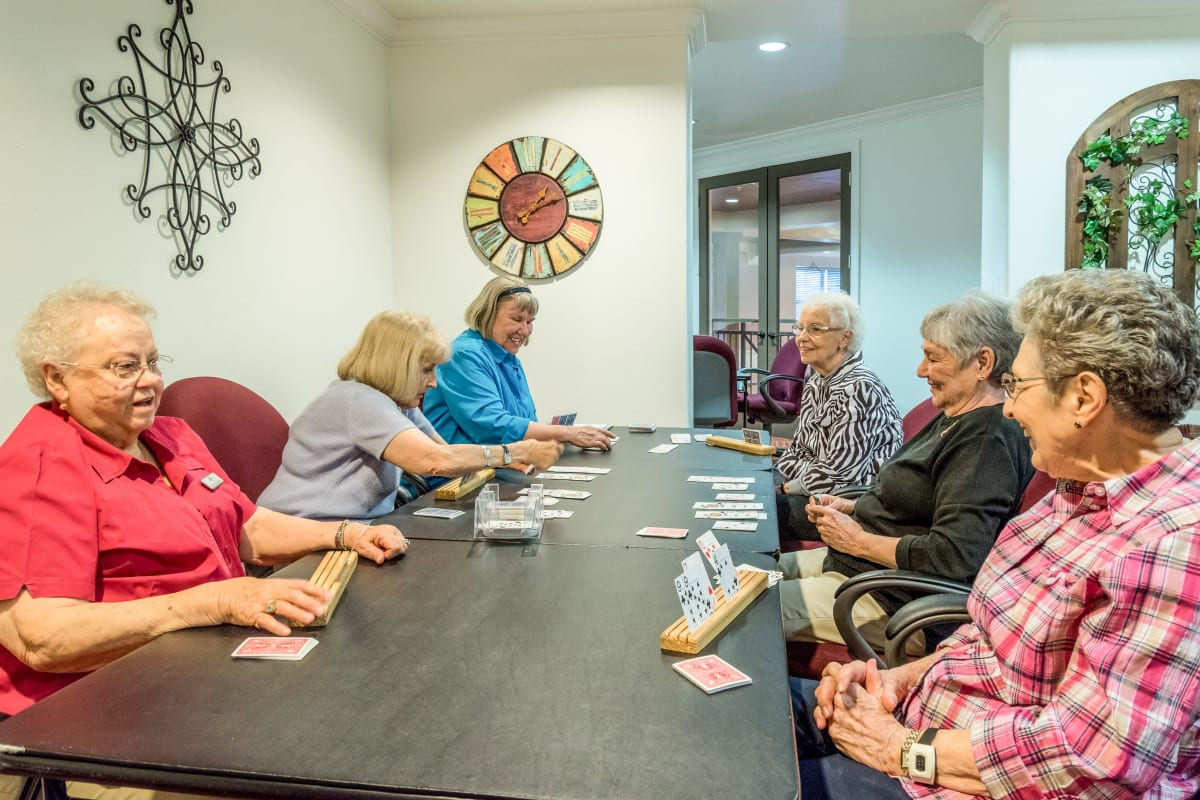 Residents playing card games at Isle at Watercrest Mansfield in Mansfield, Texas
