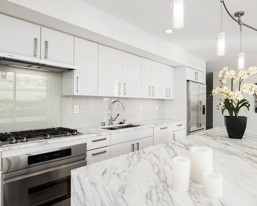 Kitchen with granite counters at The Wave at Stadium Place in Seattle, Washington