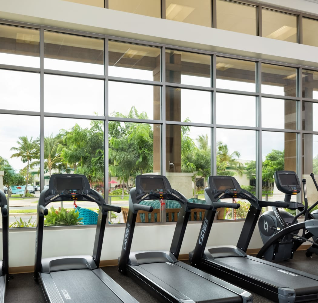 Treadmills and cardio equipment with a view in our onsite fitness center at Kapolei Lofts in Kapolei, Hawaii