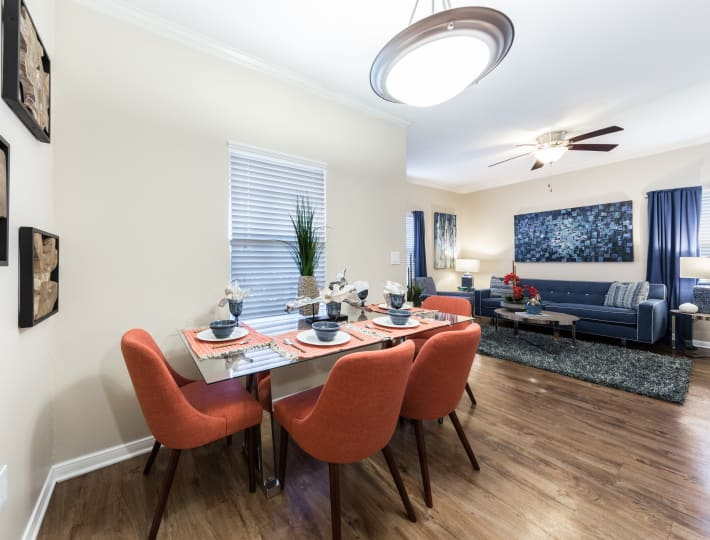 Modern living room and spacious dining room at Pavilions at Northshore in Portland, Texas