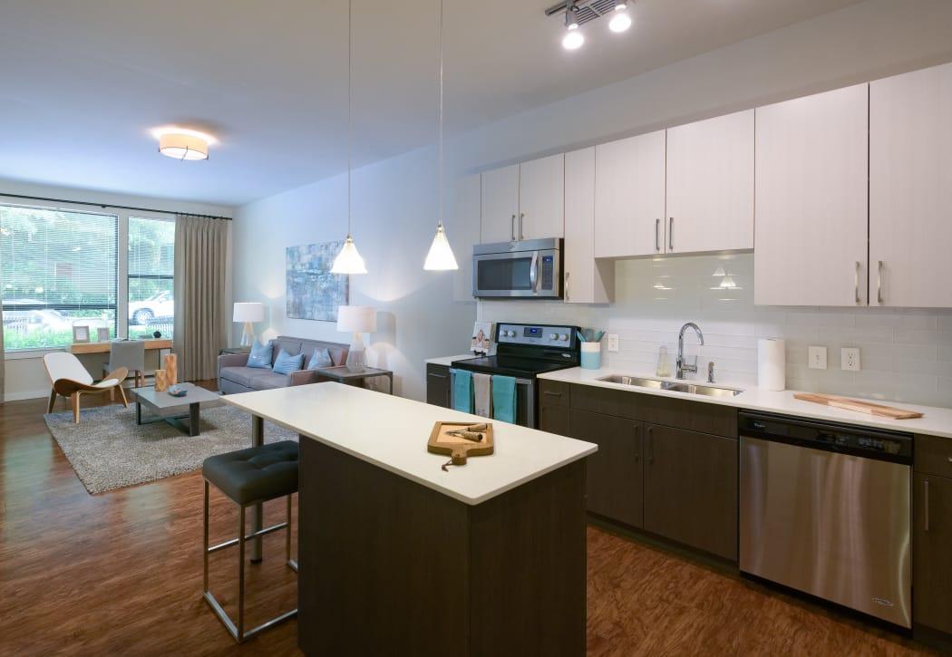 Open-concept floor plan with hardwood floors in model home at Inman Quarter in Atlanta, Georgia
