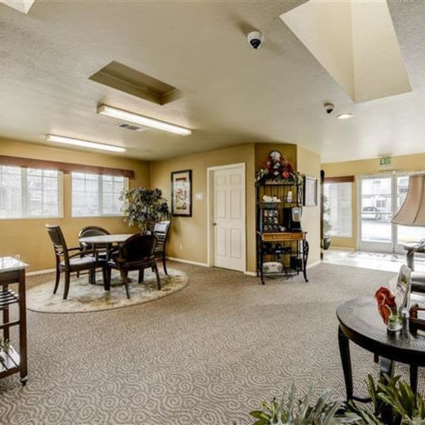 Resident lounge with table and chairs at Northwind Apartments in Reno, Nevada