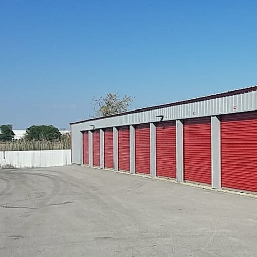 Row of storage units with red doors at Red Dot Storage in Monee, Illinois