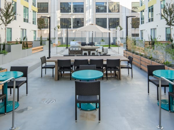 Barbecue area with gas grills in the interior open-air courtyard at EVIVA Midtown in Sacramento, California