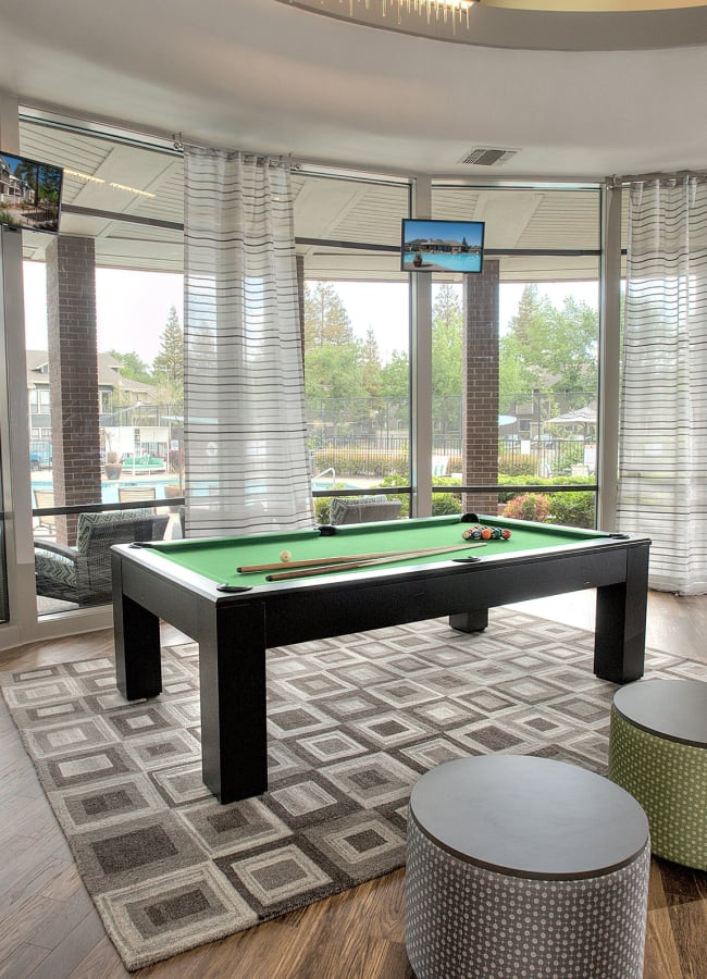 Clubhouse with a billiards table at Deer Valley Apartment Homes in Roseville, California