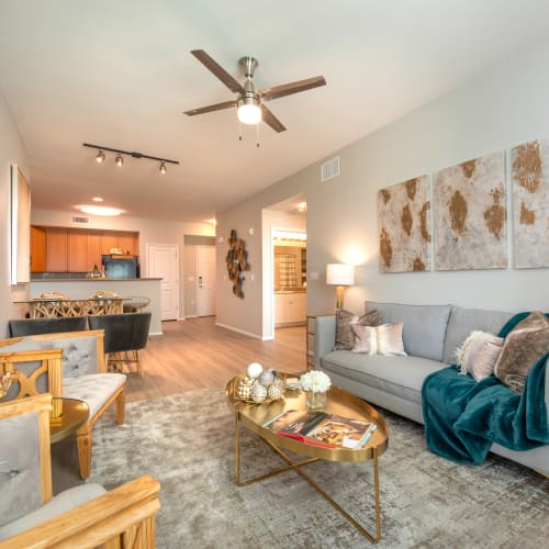 Ceiling fan and hardwood floors in a model home's living space at Olympus at Daybreak in South Jordan, Utah