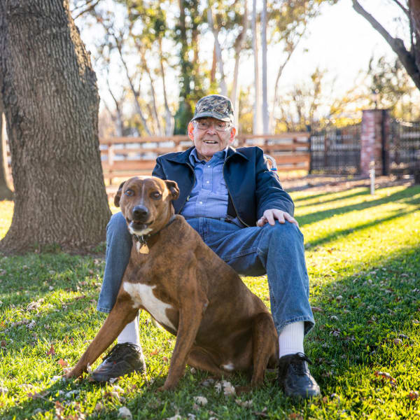 A resident and his dog at Pacifica Senior Living Menifee in Sun City, California.
