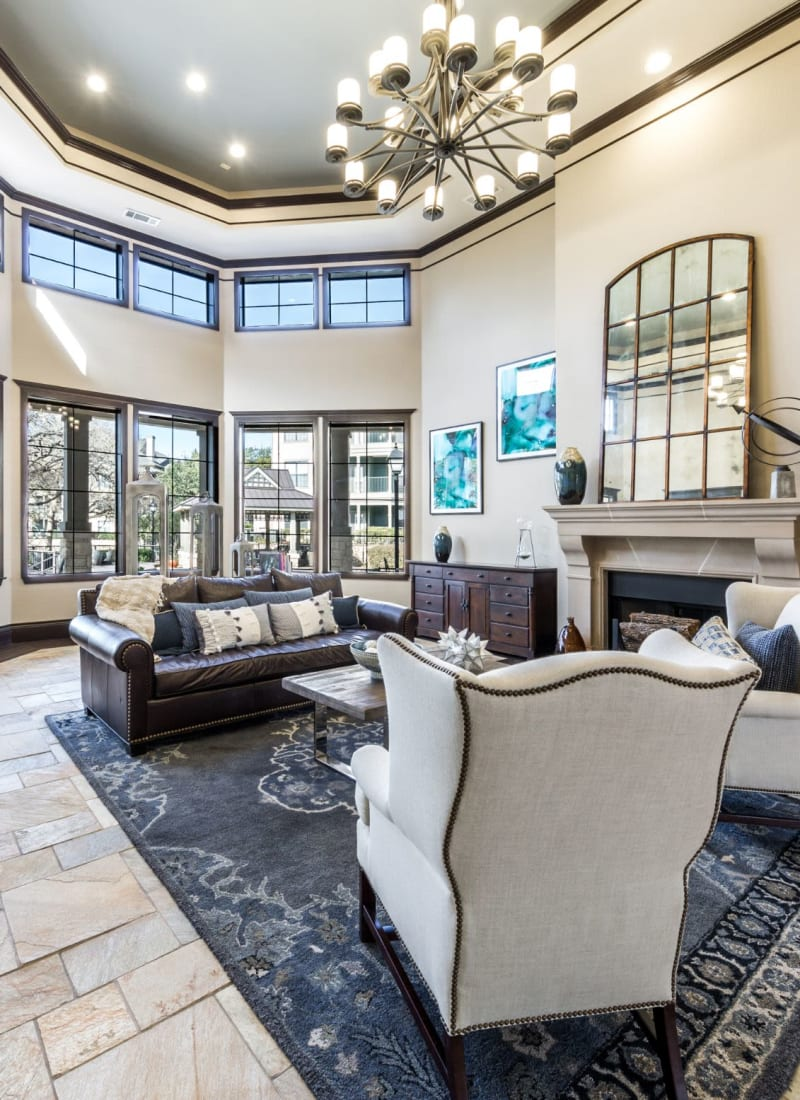Lobby entrance with sitting area and multiple large windows at The Marquis at Brushy Creek in Austin, Texas