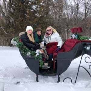 Resident Elizabeth gets a sleigh ride at Garnett Place in Cedar Rapids, Iowa.