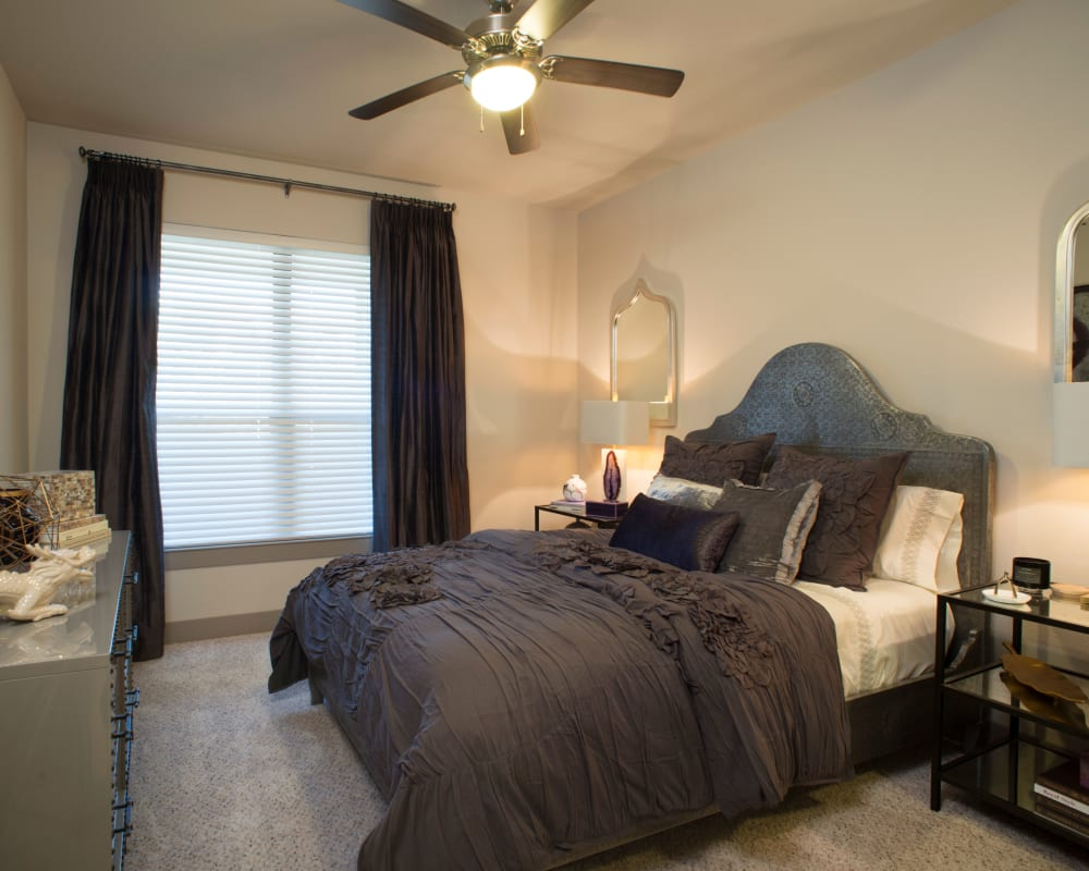Bedroom with a large window and ceiling fan at Savannah Oaks in San Antonio, Texas
