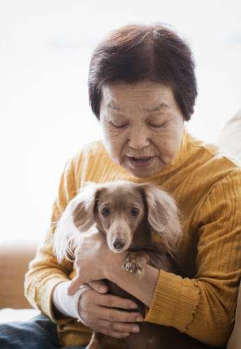 A resident holding her dog at Claiborne Senior Living.