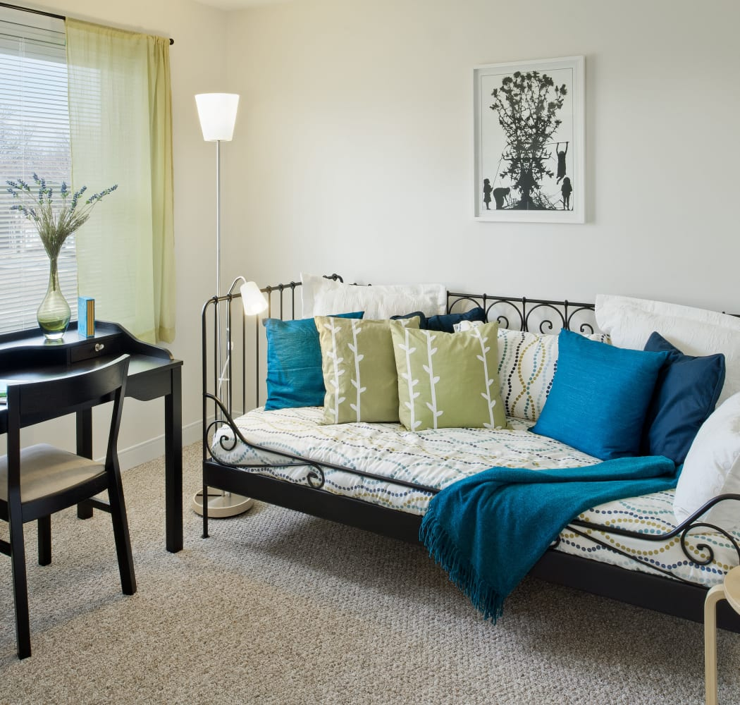 Model living room with tasteful accents at Greenwoods in Brockton, Massachusetts