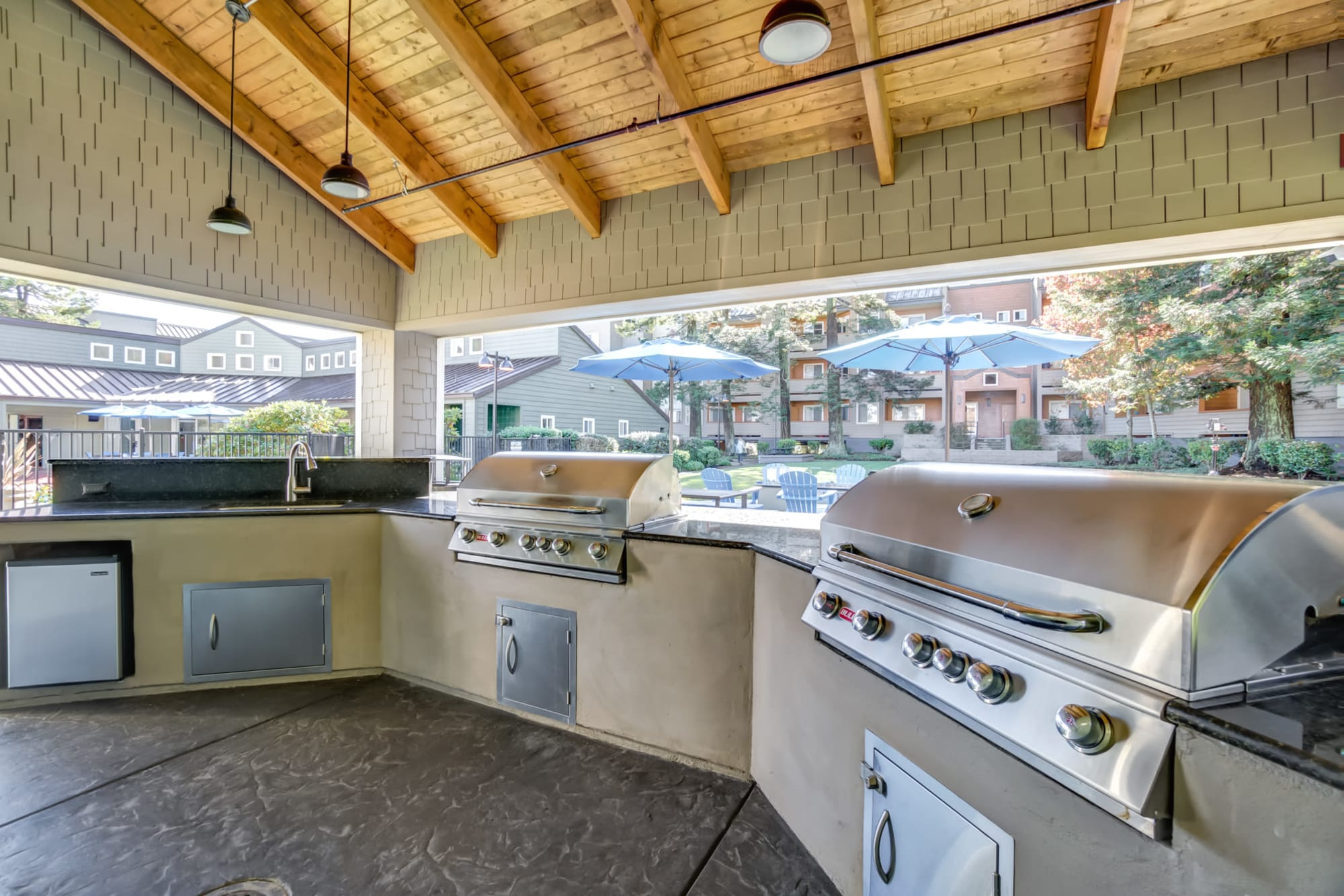 Covered BBQ Area with Bar Top Seating at Serramonte Ridge Apartment Homes