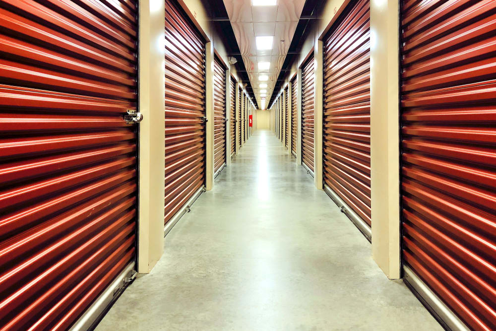 A hallway of indoor storage units at Climatrol Self Storage in Williamsburg, VA